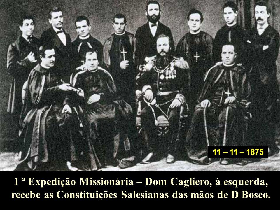 11 – 11 – 1875 1 ª Expedição Missionária – Dom Cagliero, à esquerda, recebe as Constituições Salesianas das mãos de D Bosco.
