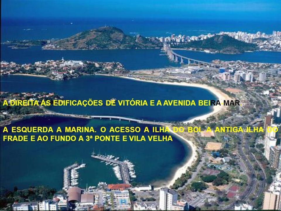 A DIREITA AS EDIFICAÇÕES DE VITÓRIA E A AVENIDA BEIRA-MAR.