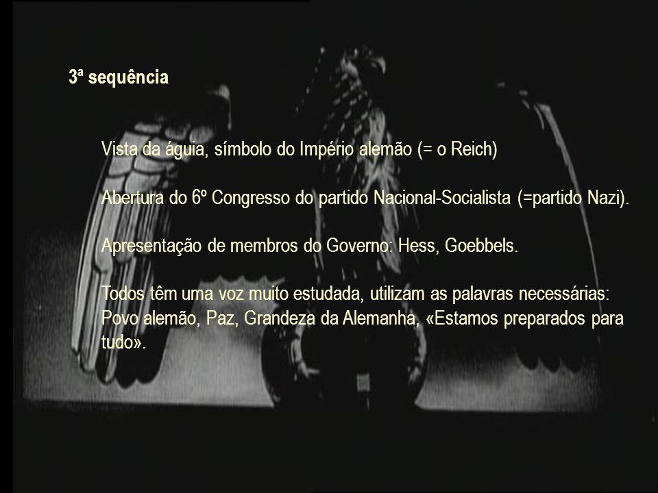 3ª sequência Vista da águia, símbolo do Império alemão (= o Reich) Abertura do 6º Congresso do partido Nacional-Socialista (=partido Nazi).