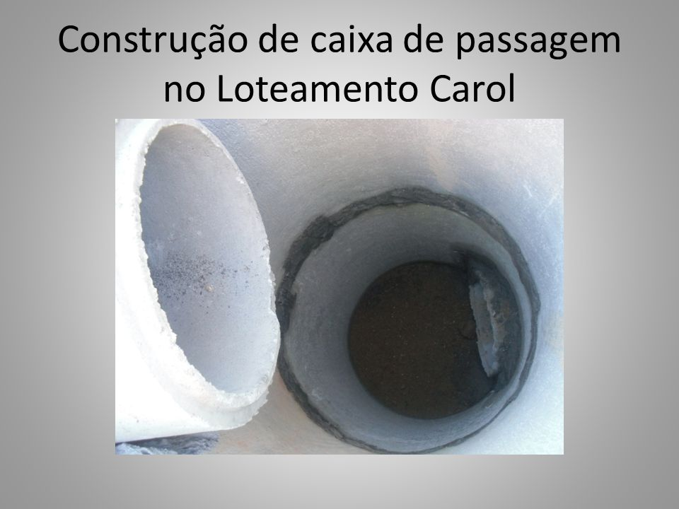 Construção de caixa de passagem no Loteamento Carol