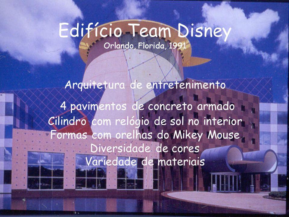 Edifício Team Disney Orlando, Florida, 1991 Arquitetura de entretenimento 4 pavimentos de concreto armado Cilindro com relógio de sol no interior Formas com orelhas do Mikey Mouse Diversidade de cores Variedade de materiais