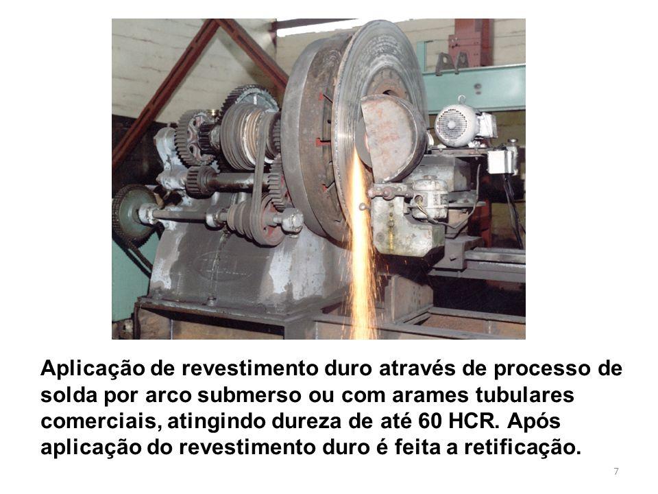 Aplicação de revestimento duro através de processo de solda por arco submerso ou com arames tubulares comerciais, atingindo dureza de até 60 HCR.