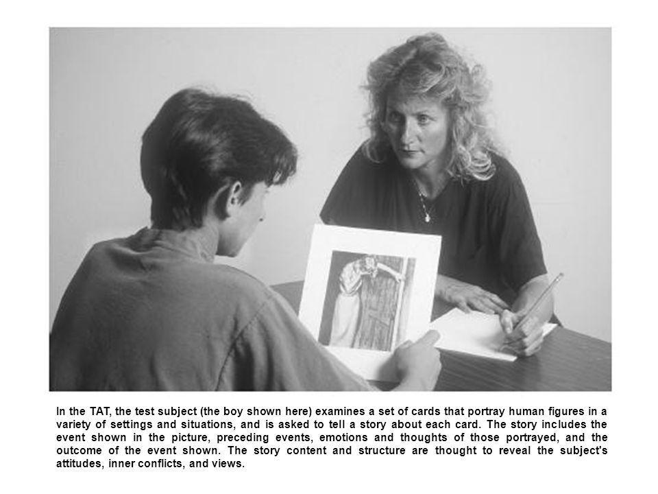 In the TAT, the test subject (the boy shown here) examines a set of cards that portray human figures in a variety of settings and situations, and is asked to tell a story about each card.