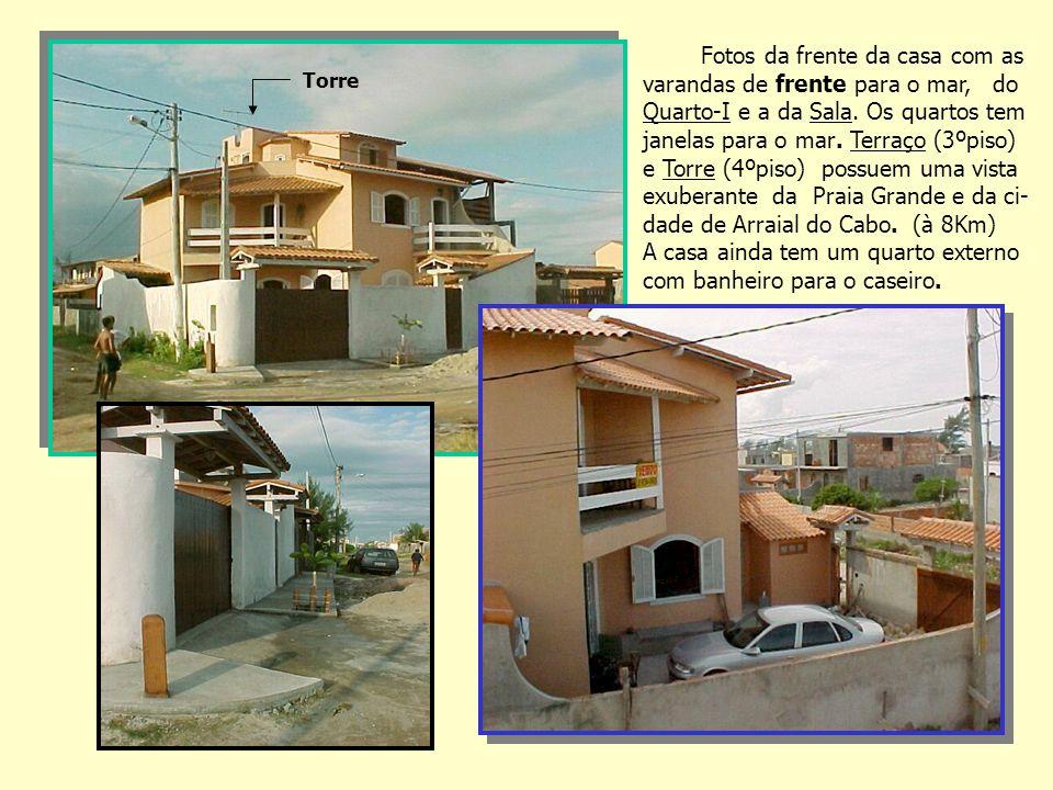 Fotos da frente da casa com as varandas de frente para o mar, do