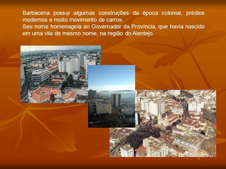 Barbacena possui algumas construções da época colonial, prédios modernos e muito movimento de carros.
