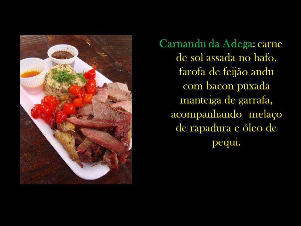 Carnandu da Adega: carne de sol assada no bafo, farofa de feijão andu com bacon puxada manteiga de garrafa, acompanhando melaço de rapadura e óleo de pequi.
