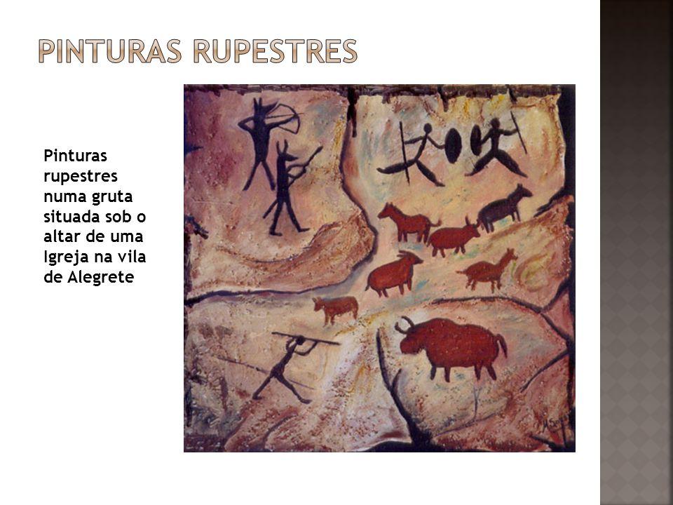 Pinturas rupestres Pinturas rupestres numa gruta situada sob o altar de uma Igreja na vila de Alegrete.