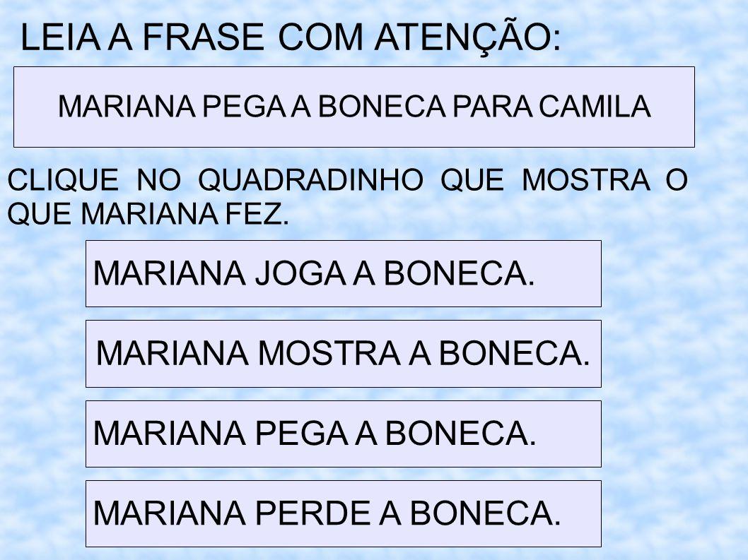 MARIANA MOSTRA A BONECA.
