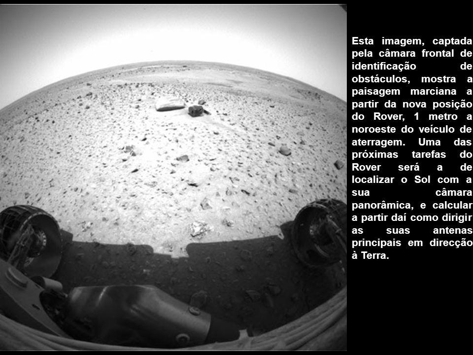 Esta imagem, captada pela câmara frontal de identificação de obstáculos, mostra a paisagem marciana a partir da nova posição do Rover, 1 metro a noroeste do veículo de aterragem.