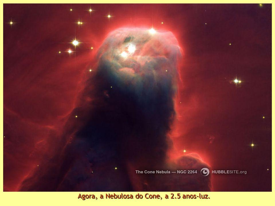Agora, a Nebulosa do Cone, a 2.5 anos-luz.