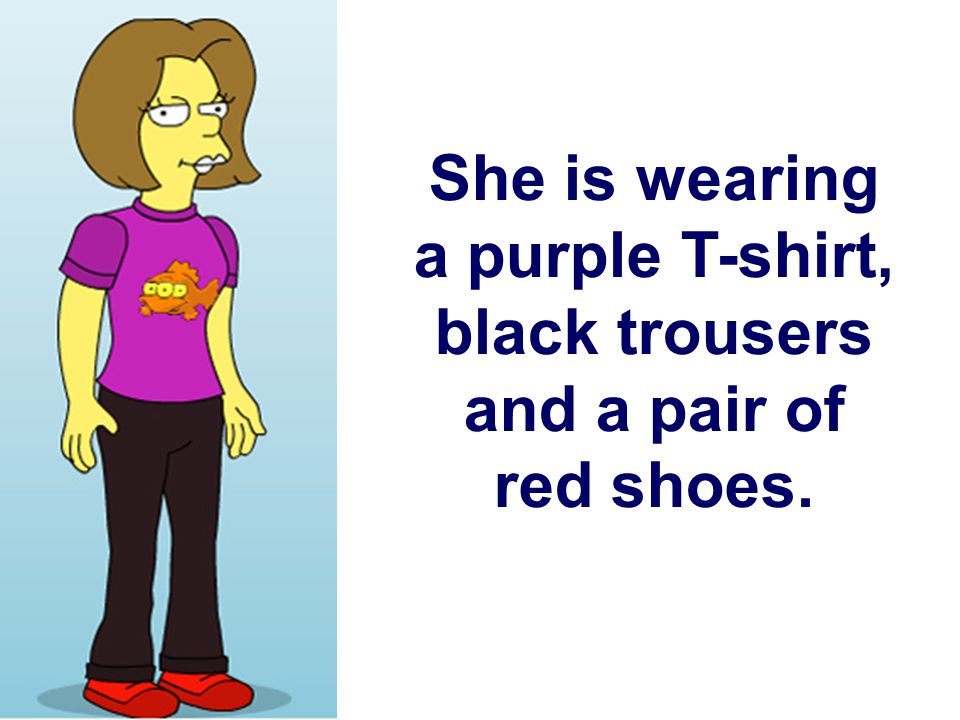 She is wearing a purple T-shirt, black trousers and a pair of red shoes.