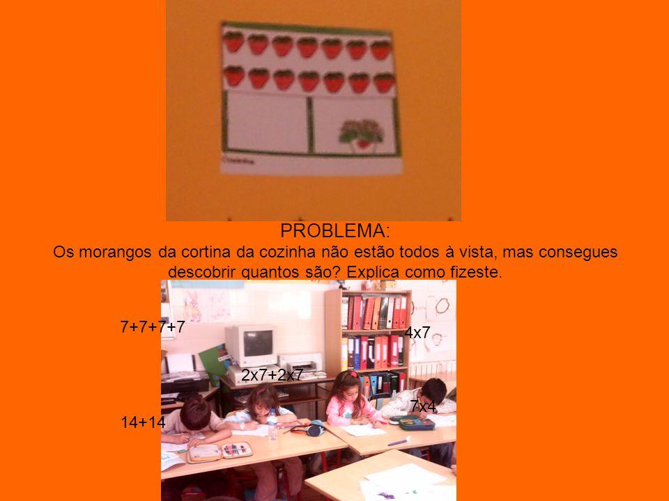 PROBLEMA: Os morangos da cortina da cozinha não estão todos à vista, mas consegues descobrir quantos são Explica como fizeste.
