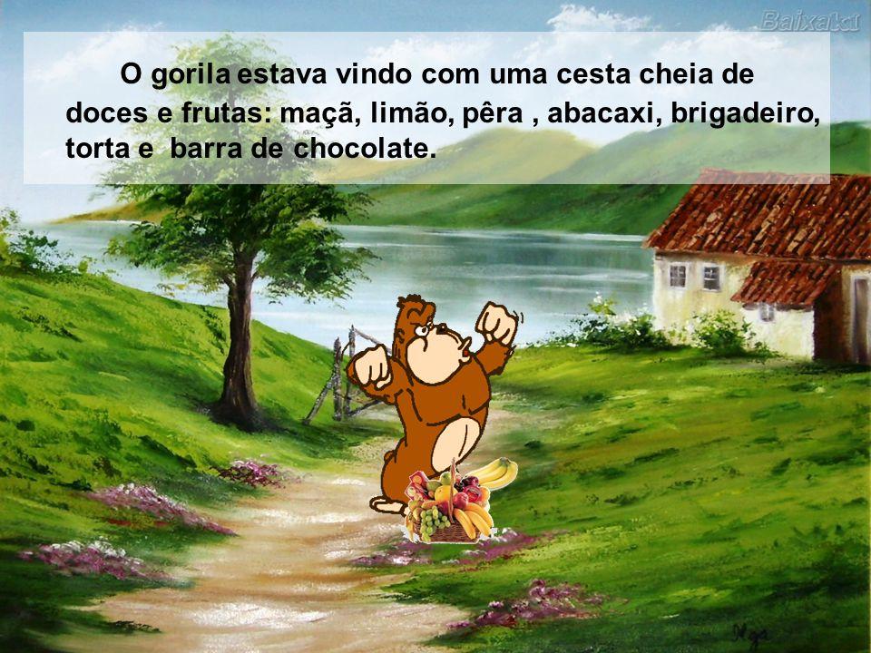 O gorila estava vindo com uma cesta cheia de doces e frutas: maçã, limão, pêra , abacaxi, brigadeiro, torta e barra de chocolate.