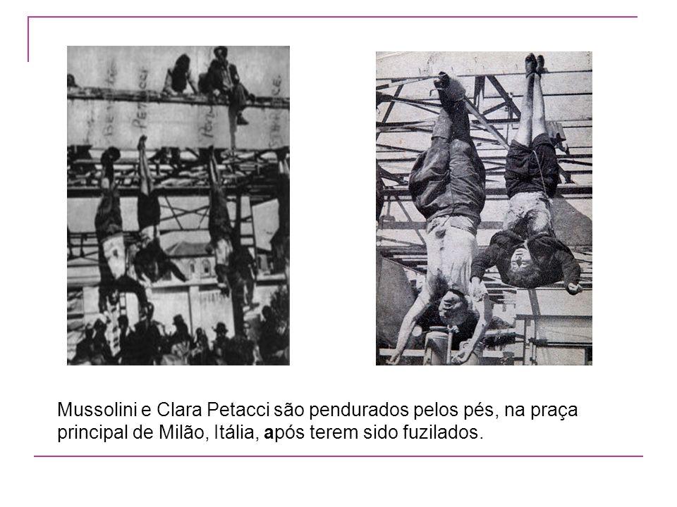 Mussolini e Clara Petacci são pendurados pelos pés, na praça principal de Milão, Itália, após terem sido fuzilados.