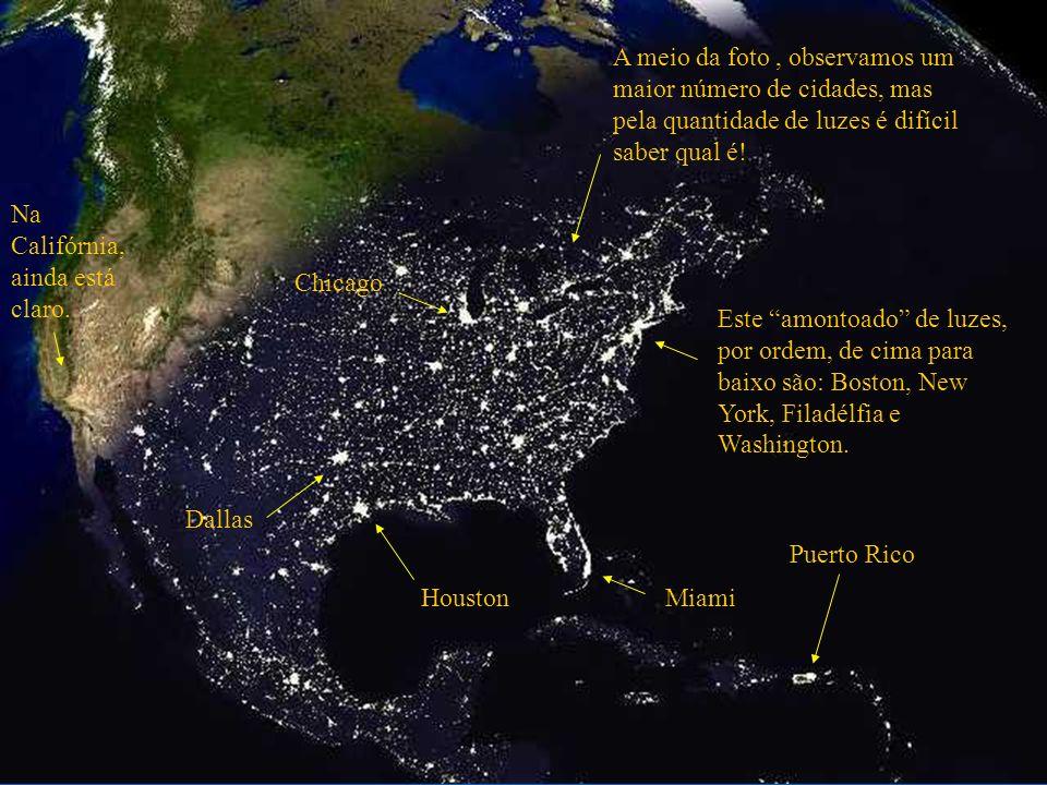 A meio da foto , observamos um maior número de cidades, mas pela quantidade de luzes é difícil saber qual é!