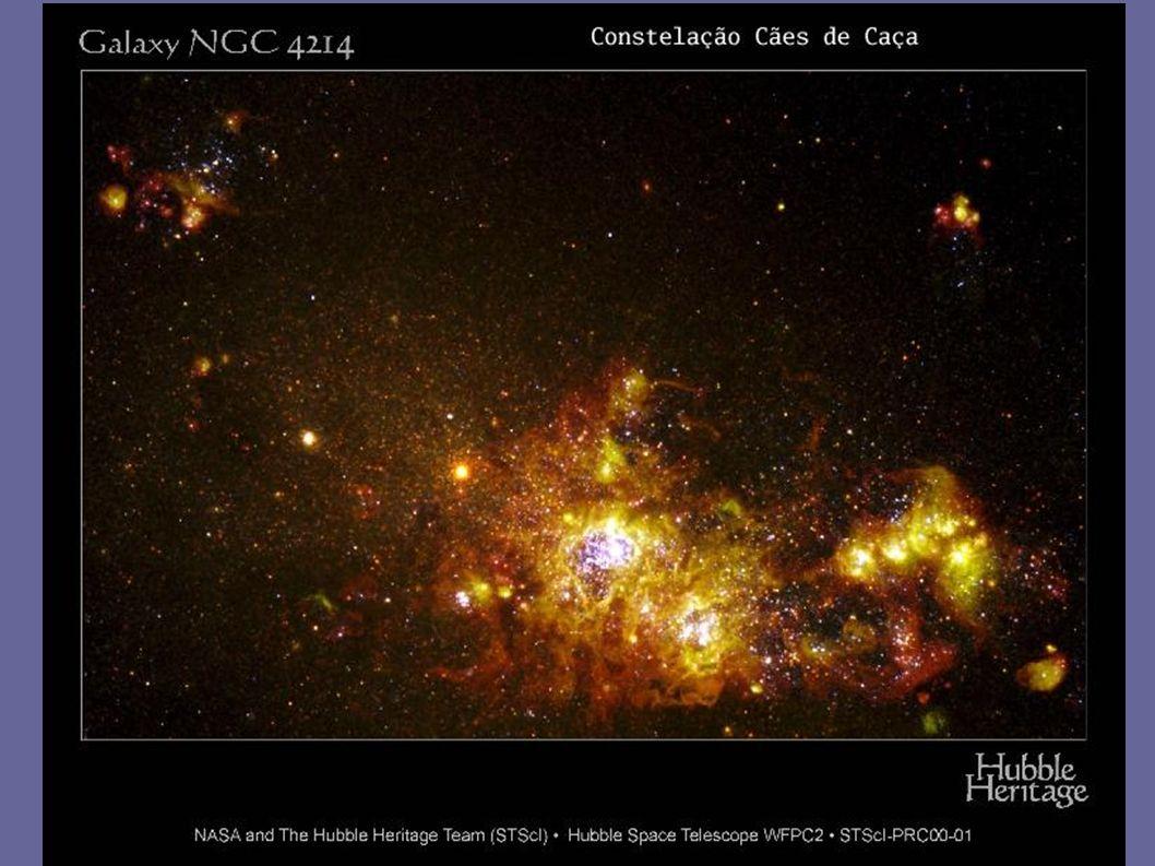 NGC 4214 Luminosidade graças à fluorescência de estrelas jovens e brilhantes (T=10.000 - 50.000 C)