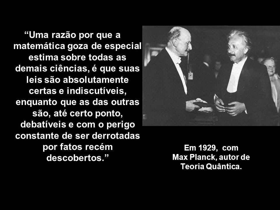 Em 1929, com Max Planck, autor de Teoria Quântica.