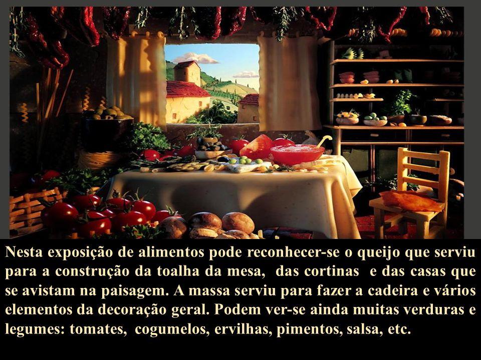 Nesta exposição de alimentos pode reconhecer-se o queijo que serviu para a construção da toalha da mesa, das cortinas e das casas que se avistam na paisagem.